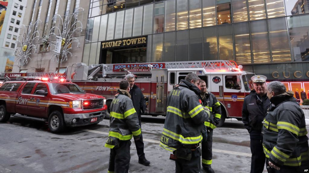 New York City Fire Dept. vehicles sit on Fifth Avenue in front of Trump Tower, in New York,  Monday, Jan. 8, 2018. Smoke has dwindled on the roof of Trump Tower in New York City. About 84 firefighters were at the scene initially.(AP Photo/Richard Drew)