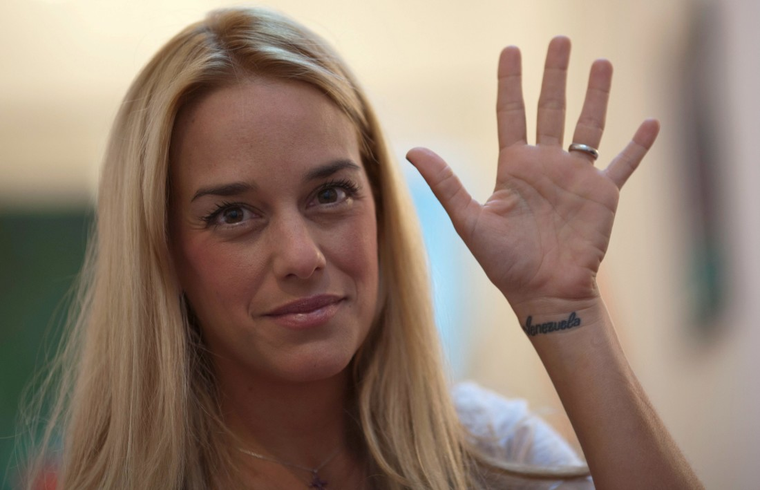 In this Oct. 29, 2014 photo, Lilian Tintori wife of opposition leader Leopoldo Lopez  shows a tattoo of the word Venezuela on her wrist during a interview at her house in Caracas, Venezuela.  Leopoldo has a matching one on his ankle. (AP Photo/Ariana Cubillos)