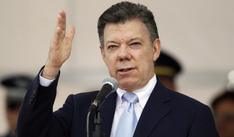 Colombia's President Juan Manuel Santos speaks during a ceremony marking the 92nd anniversary of Colombia's Air Force in Bogota, Colombia, Friday Dec. 2, 2011. (AP Photo/Fernando Vergara)