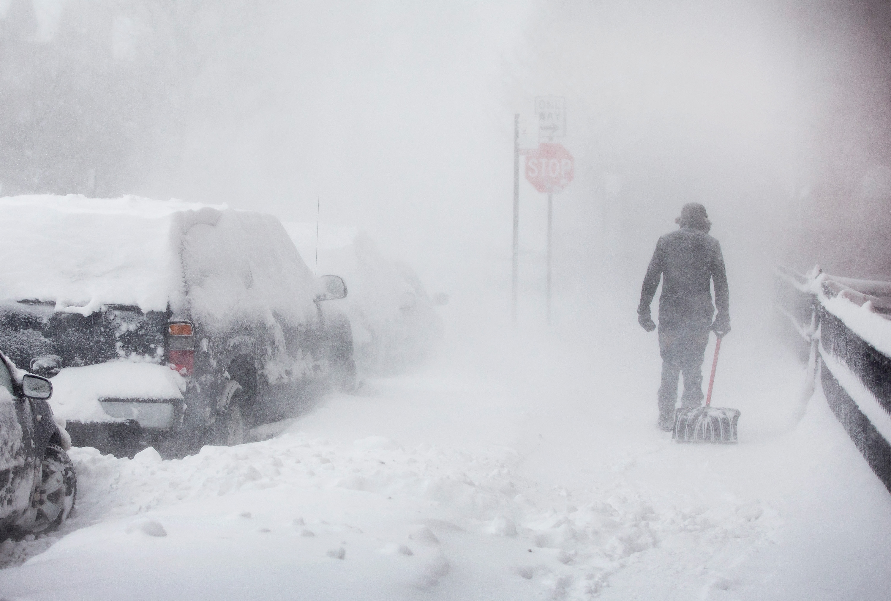 CHICAGO, IL - FEBRUARY 01: A pedestrian navigates a snow-covered sidewalk on February 1, 2015 in Chicago, Illinois. Fifteen inches or more of snow is expected to fall on the city before Monday morning. The snow has caused power outages and forced about 2,000 flight cancelations at the city's airports.  (Photo by Scott Olson/Getty Images)